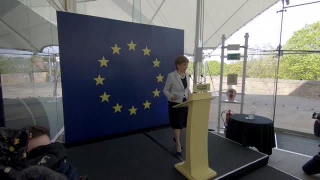 nicola sturgeon walks on stage at snp european election launch in edinburgh in front of eu flag and scotland's for europe sign - holyrood bildbanksvideor och videomaterial från bakom kulisserna