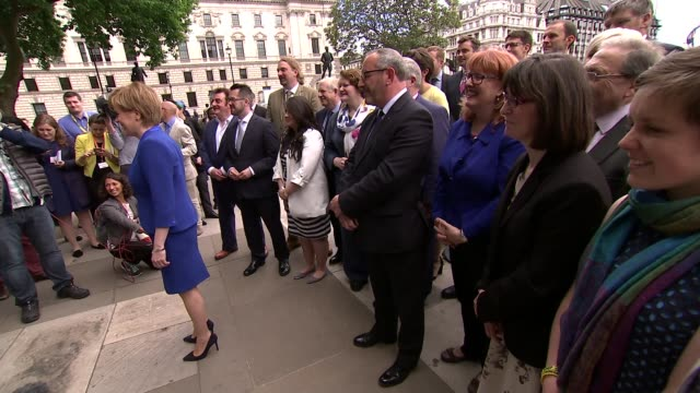 Nicola Sturgeon Westminster photo op and interview ENGLAND London Westminster EXT Various SNP MPs chatting including Mihari Black MP Nicola Sturgeon...
