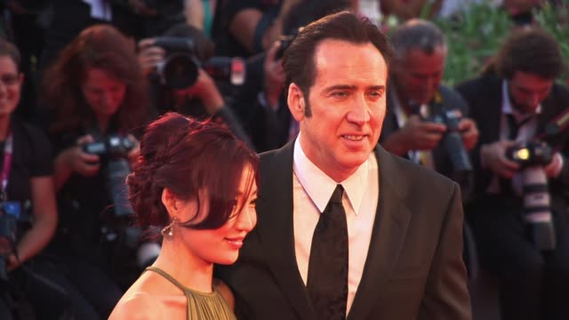 nicolas cage and alice kim cage at the 'joe' red carpet in venice italy on 8/30/13 - nicolas cage stock videos & royalty-free footage