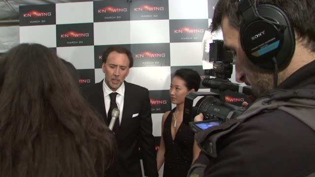 nicolas cage and alice kim cage at the special new york screening of knowing at new york ny - nicolas cage stock videos & royalty-free footage