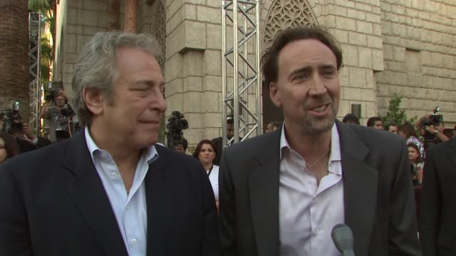 nicolas cage and charles roven on how roven feels about the award, on how cage feels about roven, and on their new movie together 'season of the... - nicolas cage stock videos & royalty-free footage