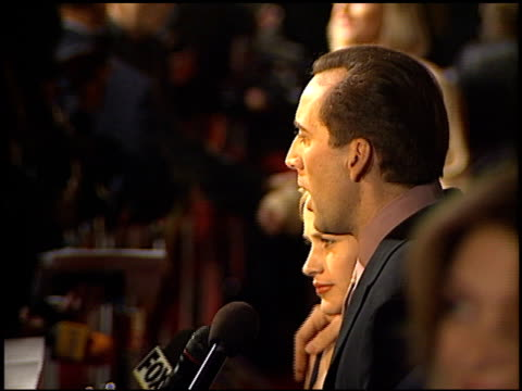 nicolas cage at the 'city of angels' premiere at the mann village theatre in westwood california on april 8 1998 - nicolas cage stock videos & royalty-free footage