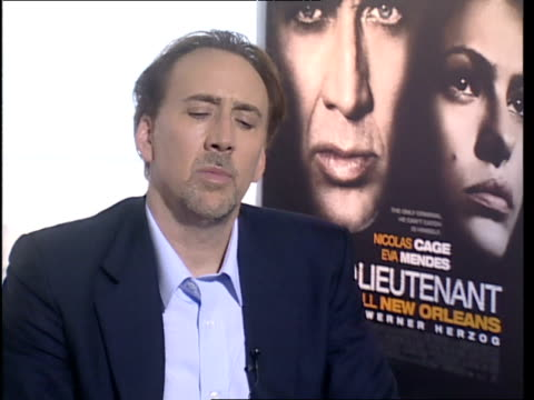 nicolas cage on how much the character sinks into him during making the film; he's able to leave it on set when he goes home but when he comes back,... - nicolas cage stock videos & royalty-free footage