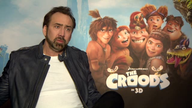 interview nicolas cage on relating to the modern family what kids will get out of the movie at the croods interviews berlin germany on the 16th of... - nicolas cage stock videos & royalty-free footage