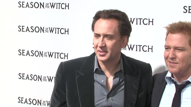 nicolas cage, ryan kavanaugh, tucker tooley and ron perlman at the 'season of the witch' new york premiere at new york ny. - tucker stock videos & royalty-free footage