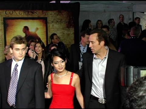Nicolas Cage with wife Alice Cage and son Weston at the 'National Treasure' Los Angeles Premiere at Pasadena Civic Auditorium in Pasadena California...