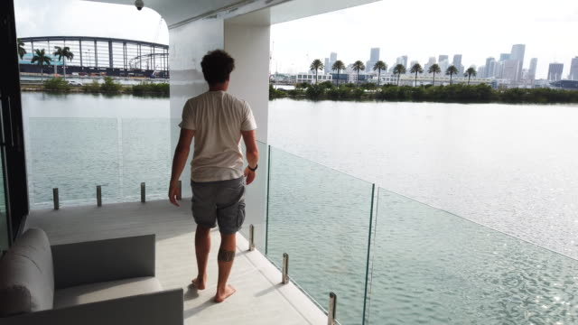 vídeos de stock e filmes b-roll de nicolas derouin cofounder of the arkup houseboat a greenenergy luxury floating home that can allow owners to adapt as the sea level continues to rise... - barco casa