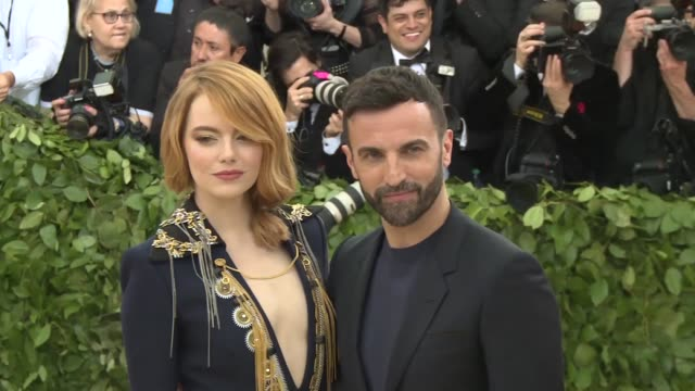 nicolas ghesquiere and emma stone at heavenly bodies: fashion & the catholic imagination costume institute gala at the metropolitan museum of art on... - 年次イベント点の映像素材/bロール