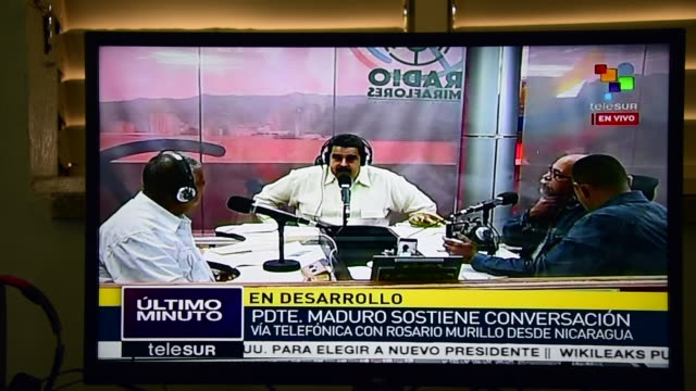 nicolas maduro personal program la hora de la salsa reaches cuban houses on a daily basis thanks to the telesur channel / the channel is financed by... - maduro stock videos & royalty-free footage