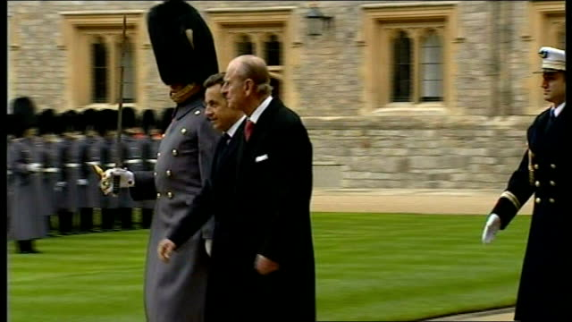 nicolas sarkozy and carla bruni arrival in windsor and inspection of guard of honour queen and president sarkozy out of carriage and stand on dais as... - guard of honour stock videos and b-roll footage
