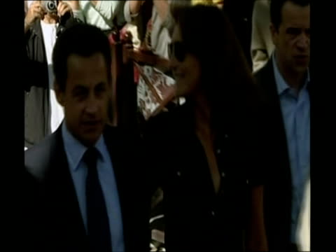 nicolas sarkozy arriving with cecilia attias to cast ballot in french presidential election / france - アナモルフィック点の映像素材/bロール
