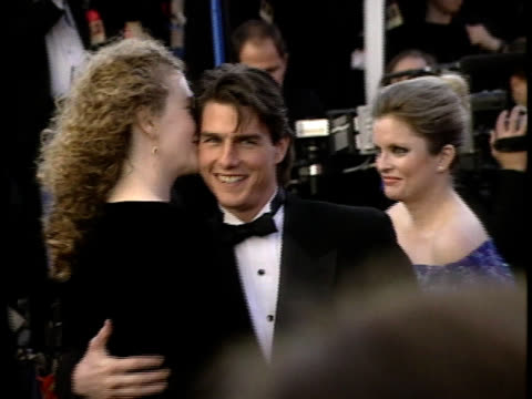 nicole kidman and tom cruise whisper to each other as they pose for paparazzi on the red carpet at the oscars - tom cruise stock videos & royalty-free footage