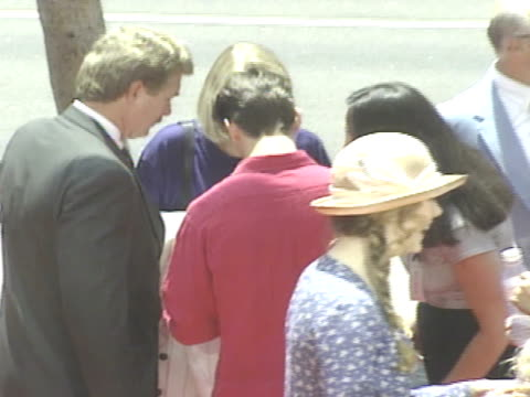 HA MS Nicole Kidman talking to fans while Tom Cruise stands behind her signing autographs on red carpet