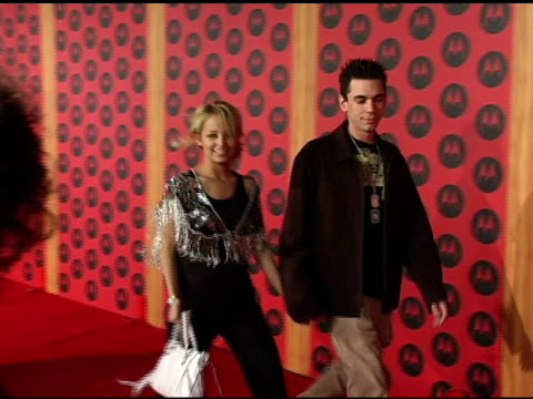 nicole richie and dj am at the motorola 6th anniversary holiday party arrivals at the music box theater in hollywood, california on december 2, 2004. - nicole richie stock videos & royalty-free footage
