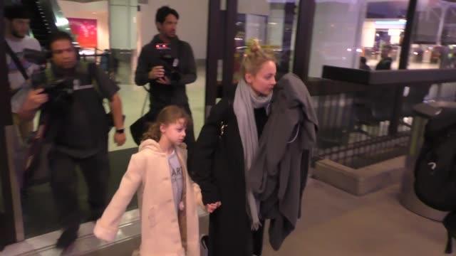 nicole richie & joel madden arriving at lax airport in los angeles in celebrity sightings in los angeles, - nicole richie stock videos & royalty-free footage