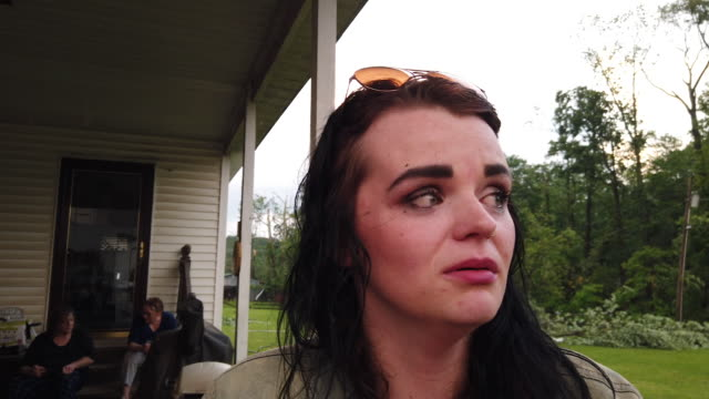 nicole rood tells how she survived a tornado by holding onto the door handle of a house as she was lifted off the ground in the 6400 block of west... - 耐久力点の映像素材/bロール