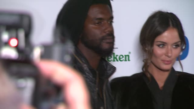 Nicole Trunfio and Gary Clark Jr at Warner Music Group 2014 Grammy Celebration at Sunset Tower Hotel on in West Hollywood California