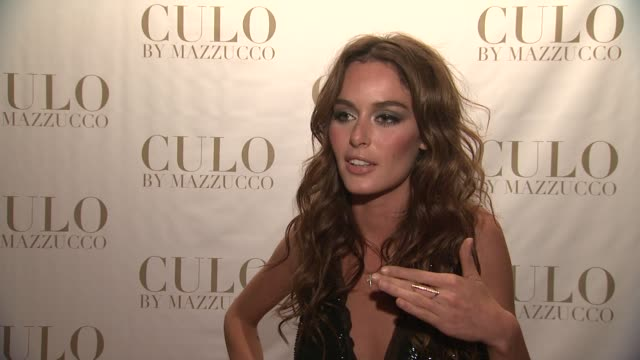 Nicole Trunfio on photographer Raphael Muzzucco at the 'CULO By Mazzucco' Launch at New York NY