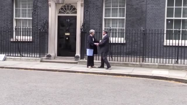 nicos anastasiades president of cyprus is greeted by theresa may as he arrives at number 10 at downing street ahead of the bilateral meeting between... - eurasia stock videos and b-roll footage