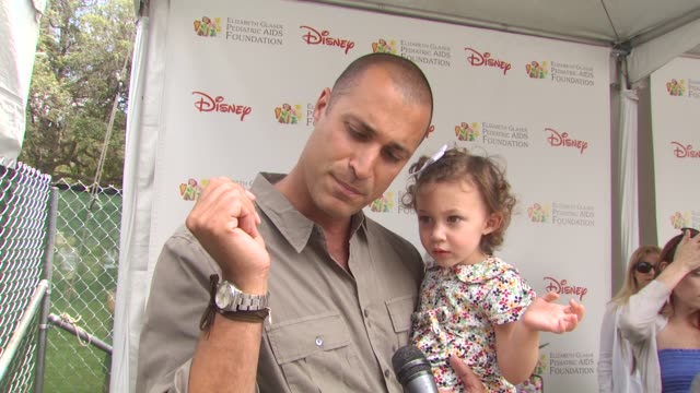 nigel barker on bracelet and importance of event at the 21st annual 'a time for heroes' celebrity picnic benefit at los angeles ca - a time for heroes stock videos & royalty-free footage