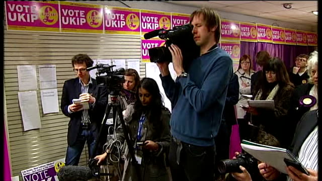 EXT Nigel Farage along high street with Richard Elvin as campaigning Nigel Farage press conference SOT I'm not an expert on football if it was...