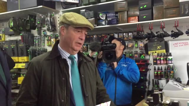 nigel farage and the brexit party candidate for ashfield martin daubney mep talking to the owners of a fishing tackle shop in eastwood notts this is... - completely bald stock videos & royalty-free footage