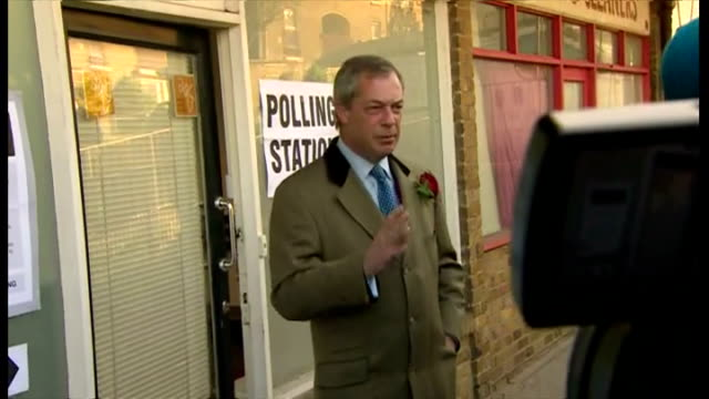 vídeos de stock e filmes b-roll de nigel farage casts his vote at polling station in ramsgate shows exterior shots nigel farage leaving the polling station after voting on may 07 2015... - ramsgate