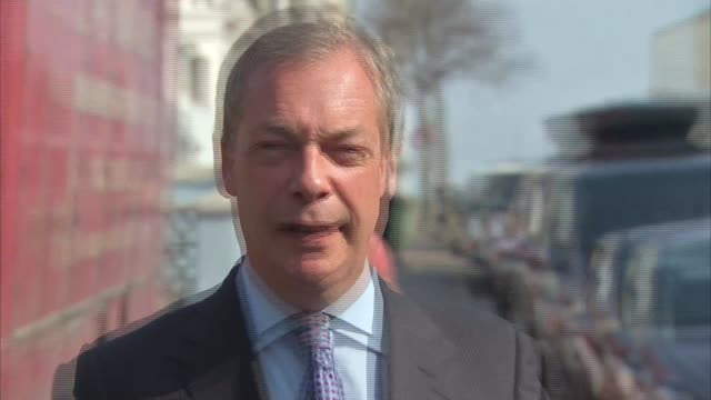 Kent Margate Leader Nigel Farage handing UKIP sign to chef and thanking for his support then along into local cafe / Nigel Farage interview SOT on...
