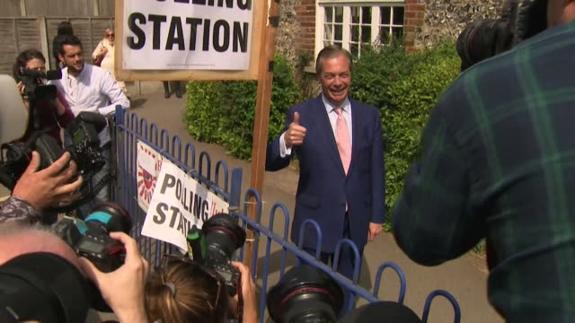 nigel farage giving thumbs up outside polling station in kent after voting in the european elections - nigel farage stock videos & royalty-free footage