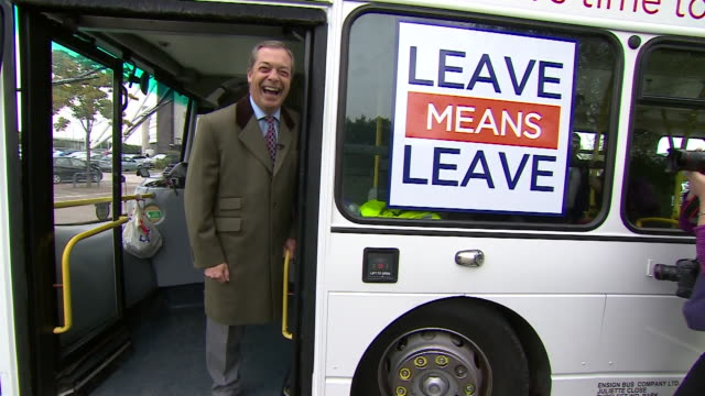 Nigel Farage posing for photographers as he stands aboard a Leave Means Leave campaign bus