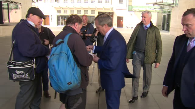 nigel farage signing autographs for supporters outside bbc broadcasting house - leaving stock videos & royalty-free footage