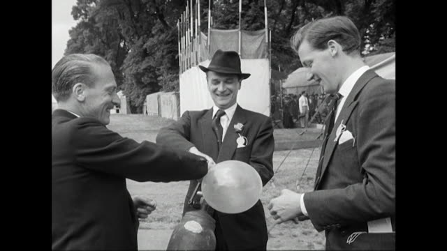 nigel patrick inflates helium balloons at a theatrical charity garden party at the royal chelsea hospital - helium stock videos & royalty-free footage