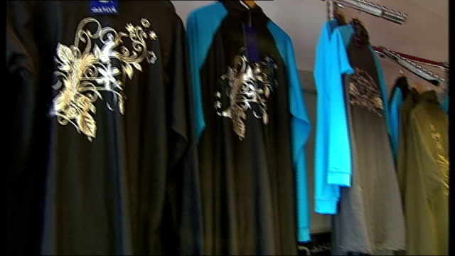 nigella lason wears 'burkini' swimming costume england london int burkini swimming costumes on display in clothes shop kausar sacranie interview sot... - swimming costume stock videos & royalty-free footage