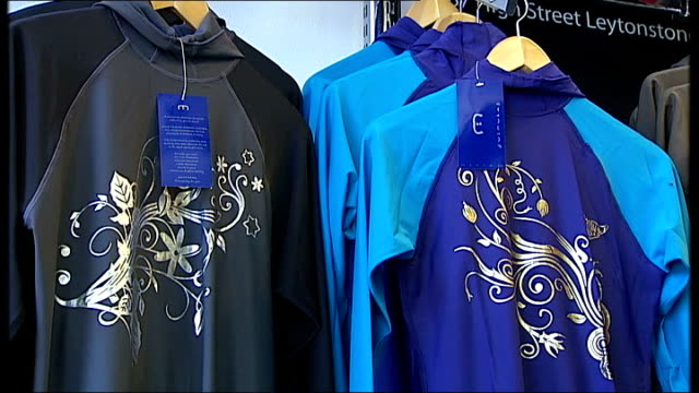 nigella lason wears 'burkini' swimming costume kausar sacranie interview sot mannequins in shop modelling burkinis burkinis on rack in shop sign in... - swimming costume stock videos and b-roll footage
