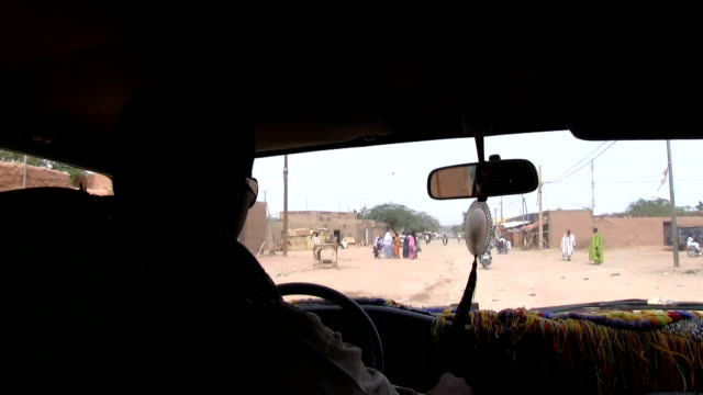 Niger Agadez driving along the sandy streets