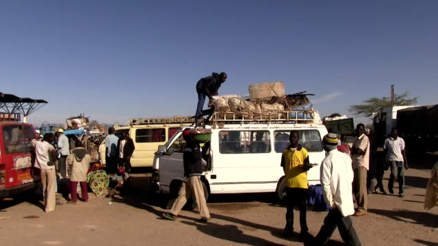 / niger agadez migrants boarding a truck loading supplies for the journey across the desert - human trafficking stock videos and b-roll footage