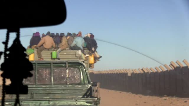 / niger agadez migrants who leave the town in trucks to cross the desert - human trafficking stock videos & royalty-free footage