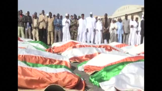niger president mahamadou issoufou and relatives pay tribute to the 71 soldiers killed on tuesday in inates in the deadliest jihadist attack on the... - mahamadou issoufou stock videos and b-roll footage