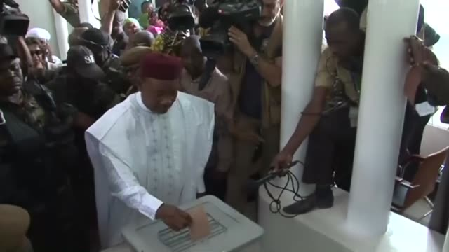 niger president mahamadou issoufou casts his ballot in the presidential elections and talks to journalist after casting his ballot in niamey, niger,... - ニアメ点の映像素材/bロール