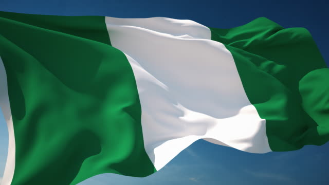 4k nigeria flag - loopable - nigeria stock videos and b-roll footage