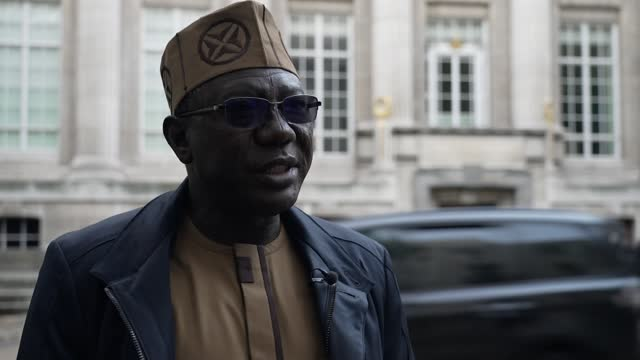 nigeria sends letter to british museum demanding return of benin bronzes; england: london: ext set up shot of reporter and professor abba isa tijani... - channel 4 news stock videos & royalty-free footage