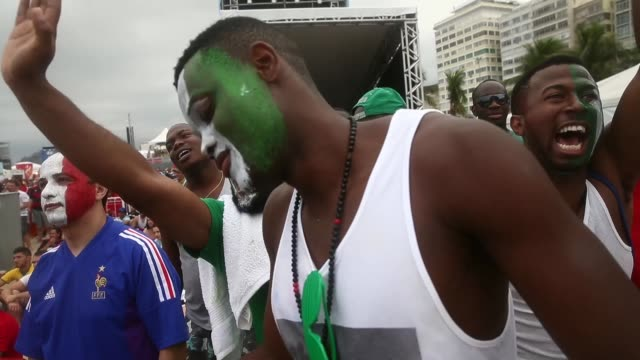 MS Nigerian and French fans watch their teams battle it out for a place in the quarter finals of the FIFA 2014 World Cup in Brazil shot in Rio de...