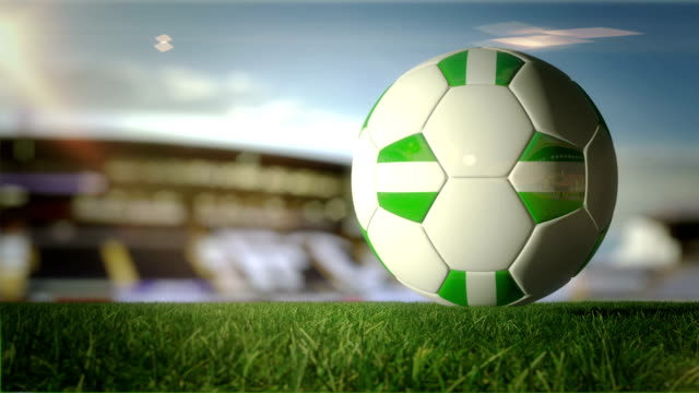 nigerian ball turn at stadium - loopable - nigerian flag stock videos & royalty-free footage
