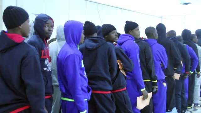 nigerian migrants who were being held at a detention centre in tripoli after entering libya illegally, enter mitiga international airport before... - emigration and immigration stock videos & royalty-free footage
