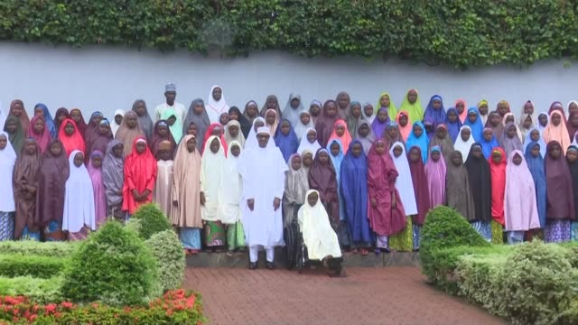 nigerian president muhammadu buhari meets the released dapchi girls in a meeting clouded by the absence of a christian student still held by boko... - militant groups stock videos & royalty-free footage