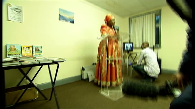 nigerian witch hunter arrives in britain england london shot behind reporter as into helen ukpabio's meeting and ushered out by security without... - witch stock videos & royalty-free footage