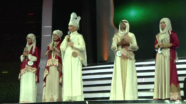 nigerian woman wins a beauty pageant exclusively for muslim women in the indonesian capital wednesday, a riposte to the miss world contest that has... - miss world pageant stock videos & royalty-free footage