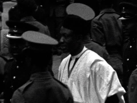 nigerians line the streets outside the nigerian embassy after gaining independence from the british - independence stock videos & royalty-free footage