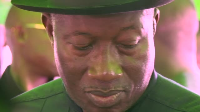 stockvideo's en b-roll-footage met nigeria's president goodluck jonathan turned up saturday to accredit himself and his wife patience for his re election bid but problems with new... - bod