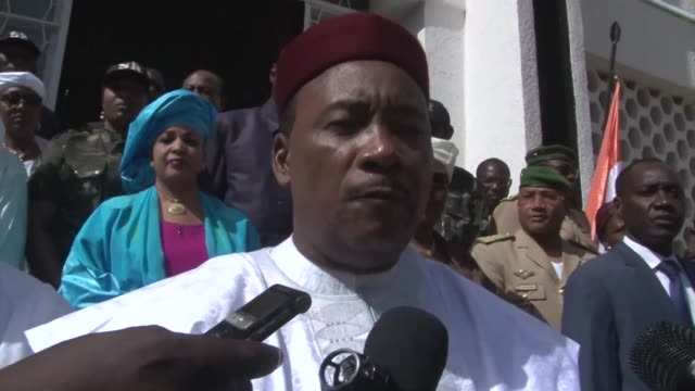 nigers incumbent president mahamadou issoufou votes in the countrys first ever presidential run off as the opposition observes a boycott - mahamadou issoufou stock videos and b-roll footage
